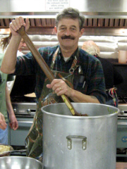 Ted Pack stirring 30 pounds of string beans for the homeless dinner